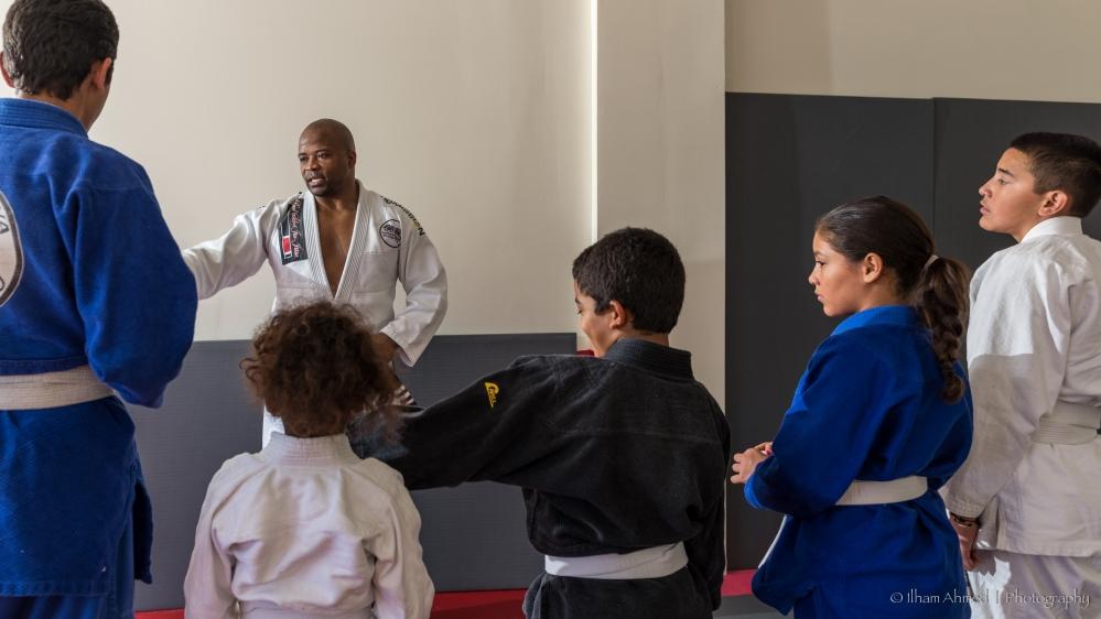 Rafael Davis teaching JJ students, Photo courtesy of Ilham Ahmed Photography