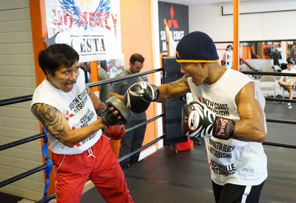 Mercito and father Anecito at open workout, photograph courtesy of Neil Mascasadia