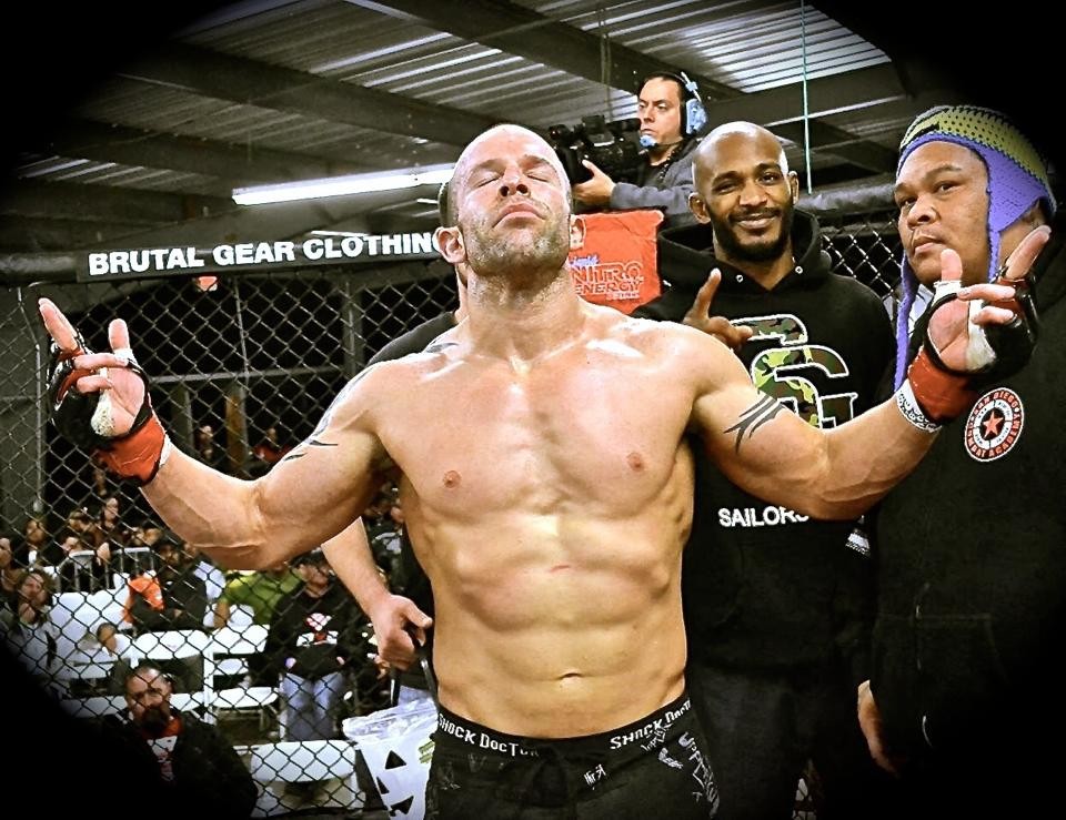 George Hernandez in the Octagon. Hat tip to Lance Emery for the pictures.