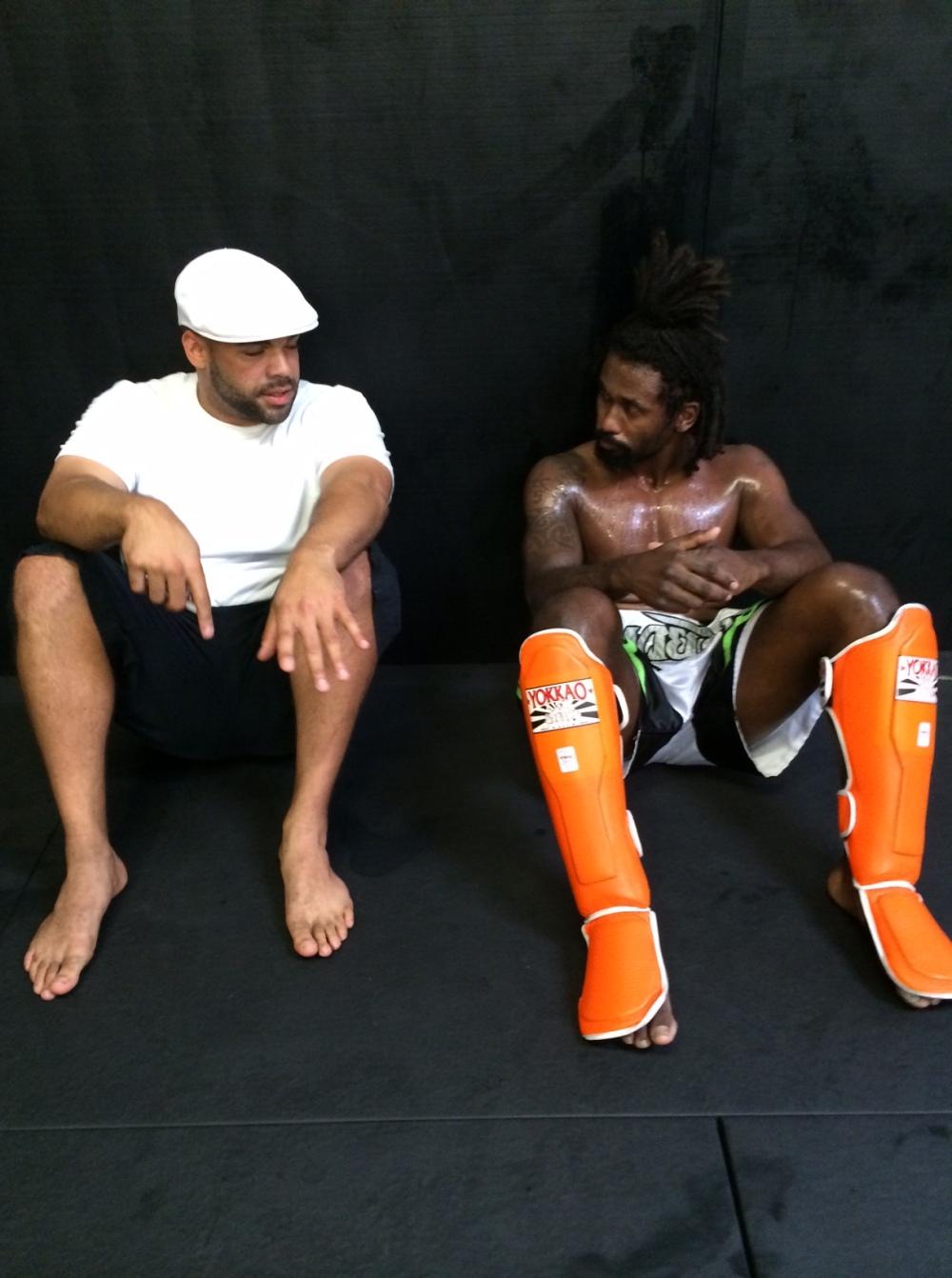 Adam Heard and Alex Higley during a break in training